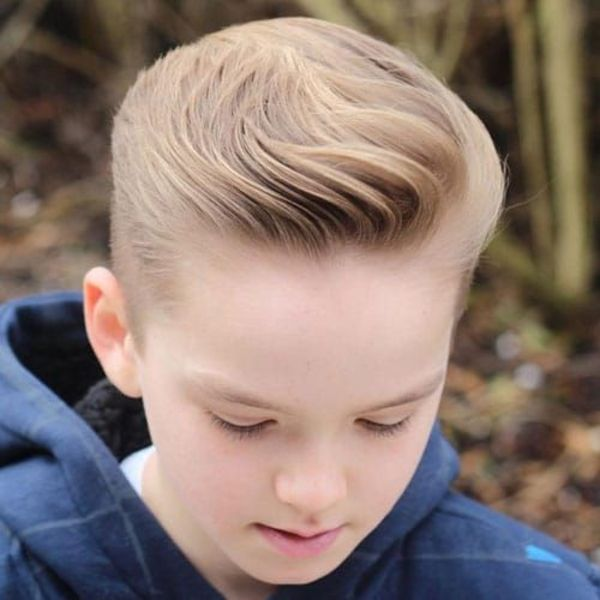 wavy brushed back undercut hairstyle
