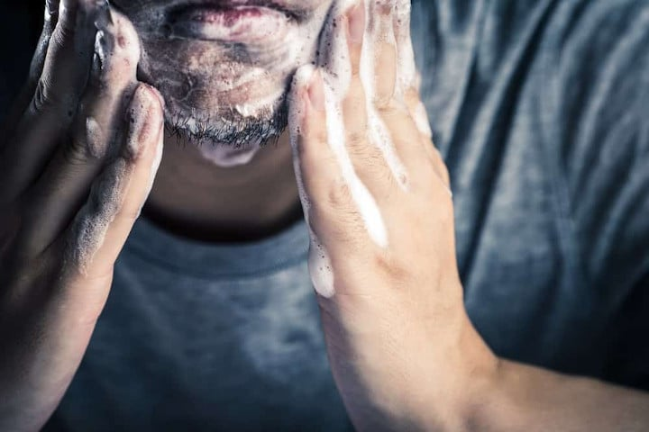 man washing beard close up