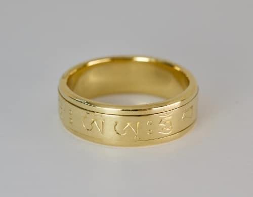 18 carat gold spinning mantra ring