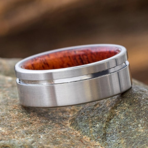 mahogany wood titanium ring with grooved offset pinstripe