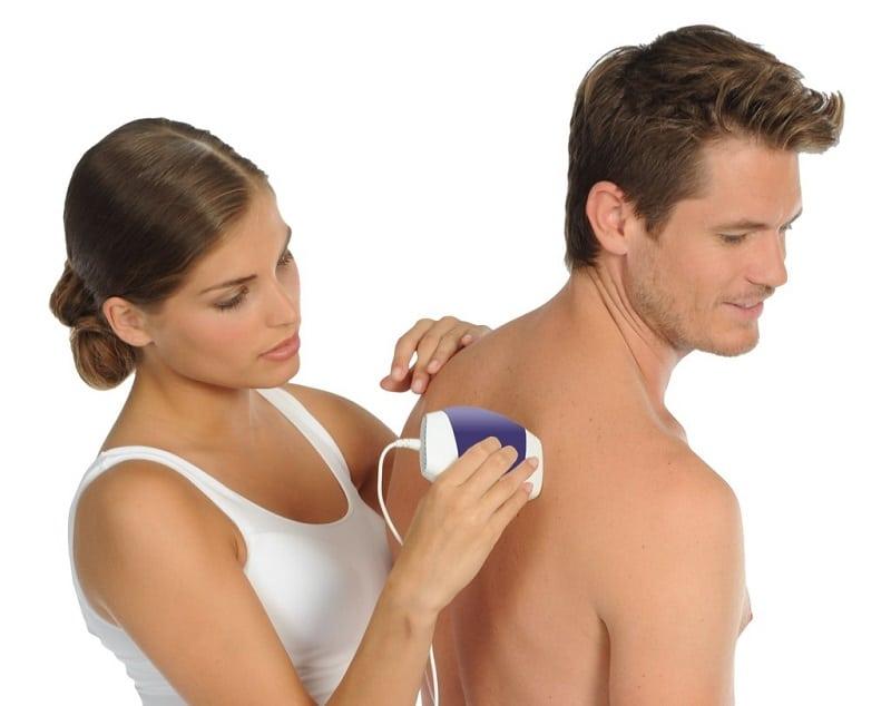 woman using hair removal machine